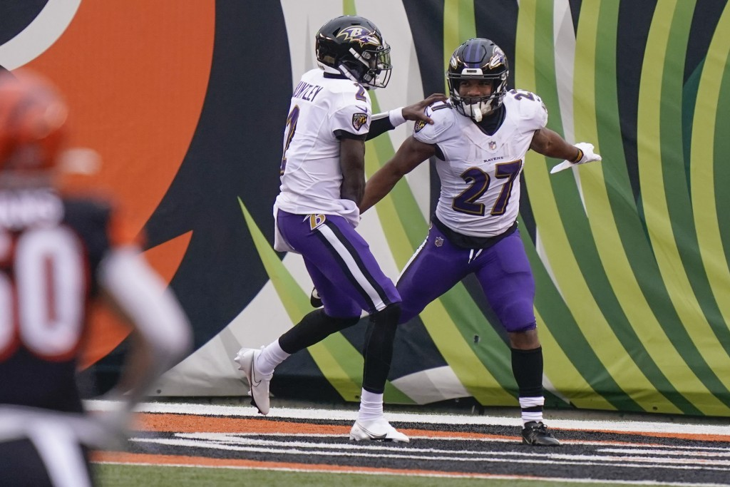 Baltimore Ravens running back J.K. Dobbins (27) celebrates with quarterback Tyler Huntley (2) after scoring a touchdown against the Cincinnati Bengals...