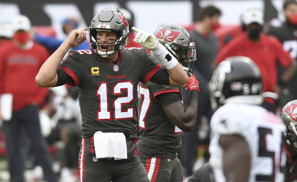 Tampa Bay Buccaneers quarterback Tom Brady (12) calls a play against the Atlanta Falcons during the second half of an NFL football game Sunday, Jan. 3...