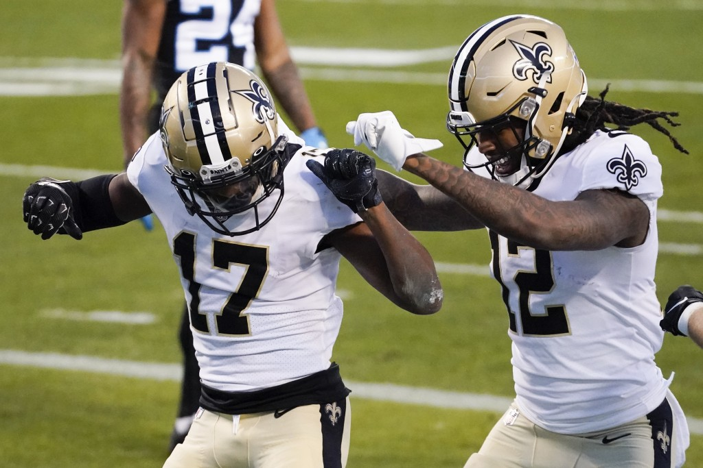 New Orleans Saints wide receiver Emmanuel Sanders celebrates after scoring with wide receiver Marquez Callaway during the first half of an NFL footbal...