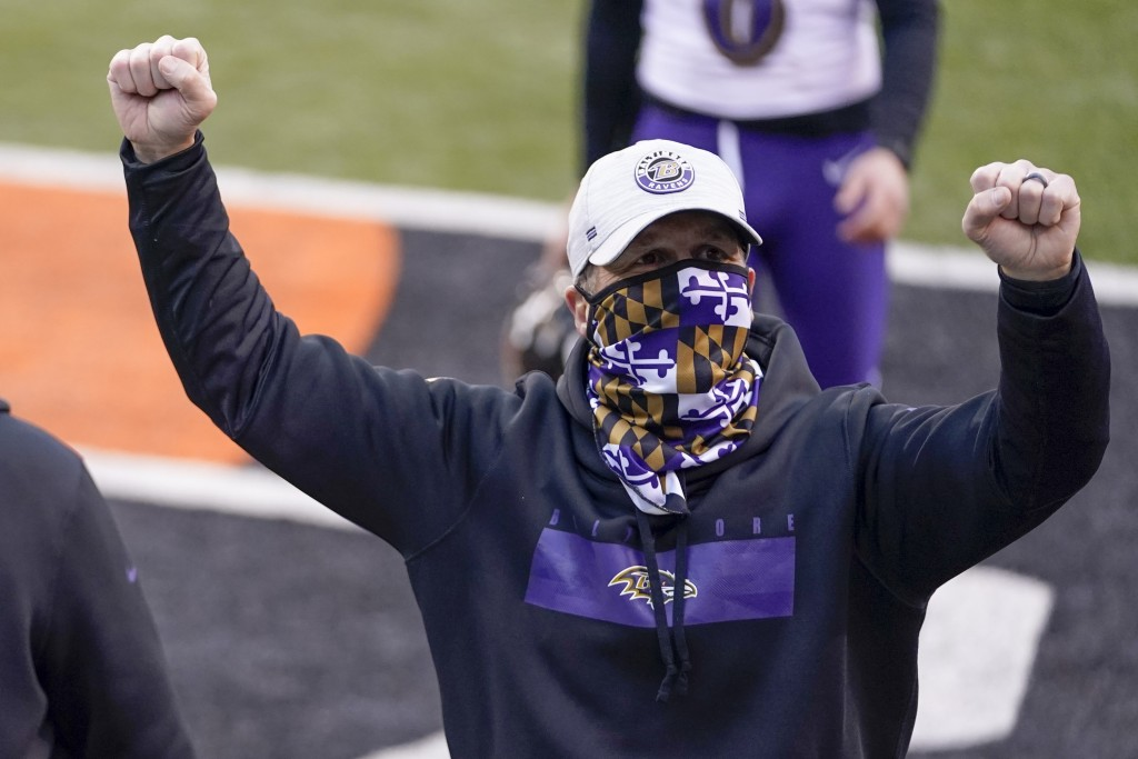 Baltimore Ravens head coach John Harbaugh celebrates after a victory over the Cincinnati Bengals in the NFL football game, Sunday, Jan. 3, 2021, in Ci...