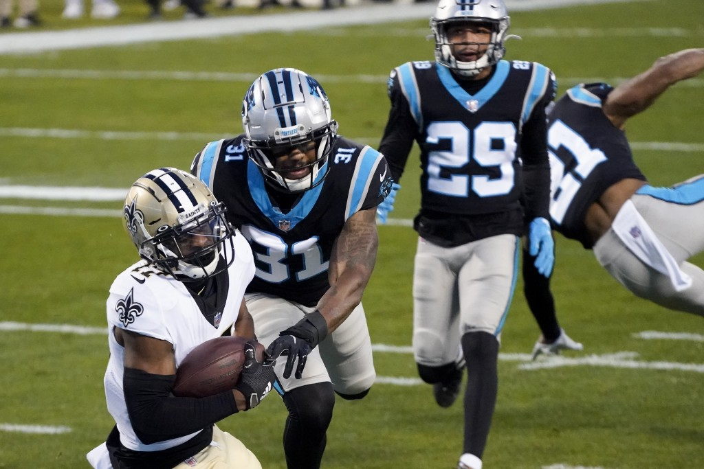 New Orleans Saints wide receiver Emmanuel Sanders scores past Carolina Panthers strong safety Juston Burris during the first half of an NFL football g...