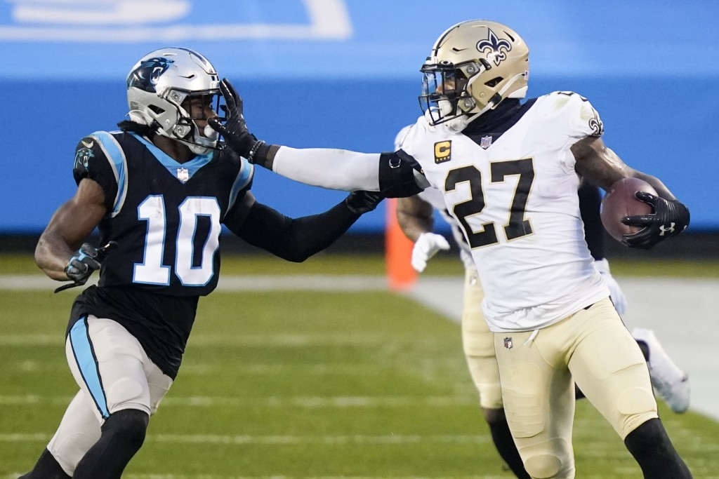 New Orleans Saints strong safety Malcolm Jenkins runs around Carolina Panthers wide receiver Curtis Samuel during the first half of an NFL football ga...
