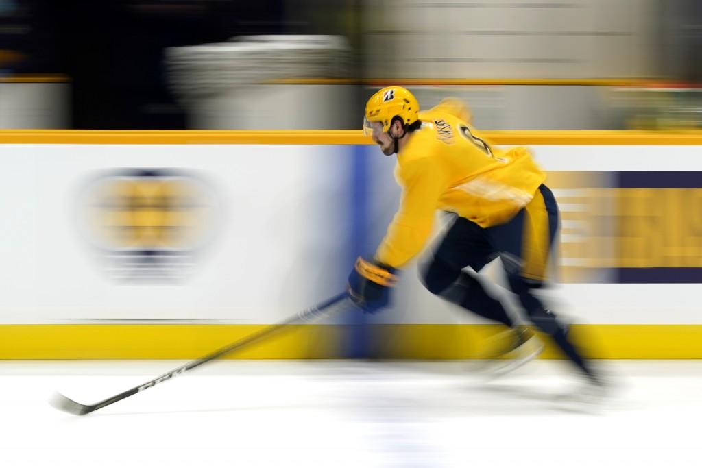 Nashville Predators left wing Filip Forsberg skates down the ice during NHL hockey training camp Monday, Jan. 4, 2021, in Nashville, Tenn. (AP Photo/M...