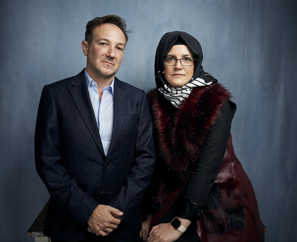 """FILE - Director Bryan Fogel, left, and  Hatice Cengiz pose for a portrait to promote """"The Dissident,"""" a film about slain journalist Jamal Khashoggi, d..."""