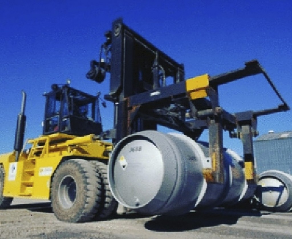FILE - In this. file photo, released on Wednesday, Nov. 6, 2019, by the Atomic Energy Organization of Iran, a forklift carries a cylinder containing u...