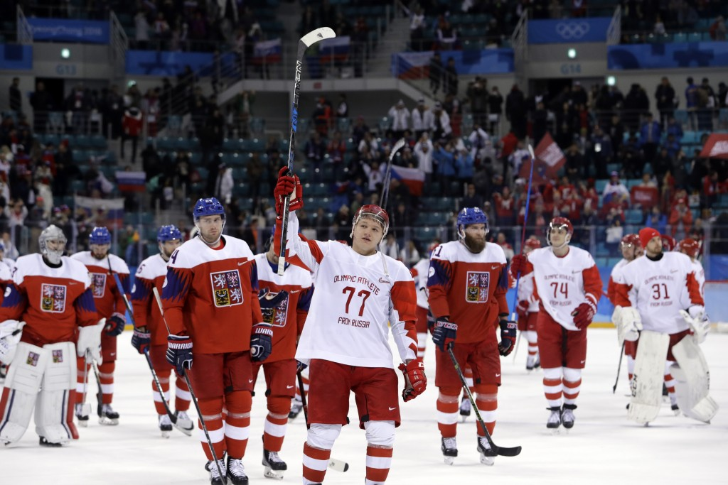 FILE - Russian athlete Kirill Kaprizov (77) celebrates after the semifinal round of the men's hockey game against the Czech Republic at the 2018 Winte...