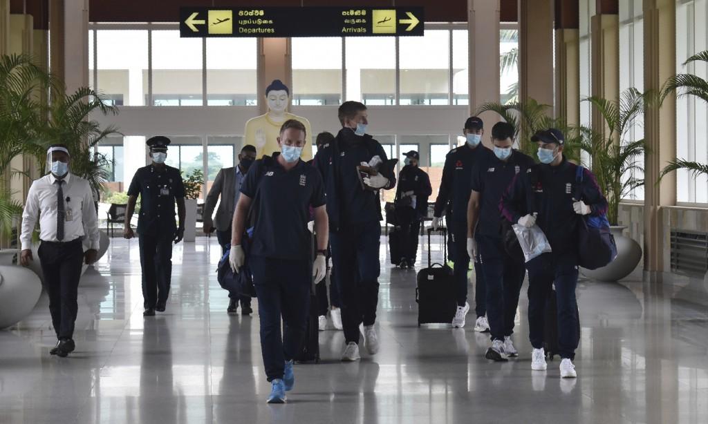 England cricketers walk along the arrivals terminal at Mattala Rajapaksa International airport in Hambantota, Sri Lanka, Sunday, Jan. 3, 2021. Team al...