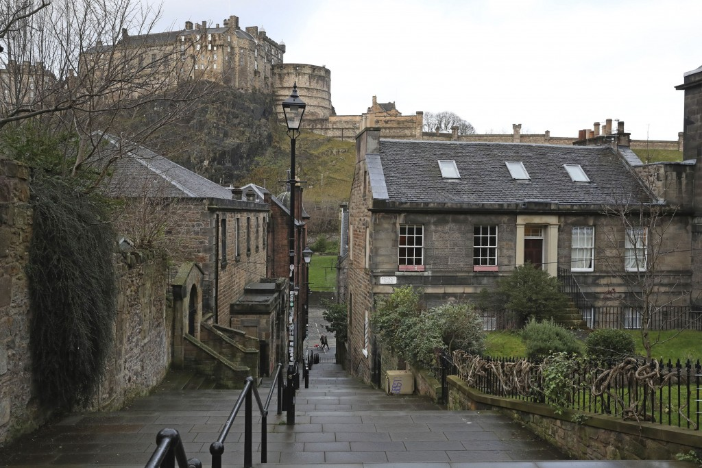 Quiet streets near Edinburgh Castle, the morning after stricter COVID-19 lockdown measures came into force for mainland Scotland, Tuesday Jan. 5, 2021...