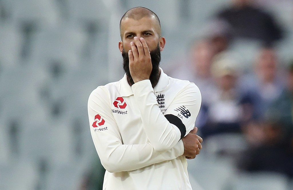 FILE - In this Dec. 2, 2017, file photo, England's Moeen Ali puts his hand over his face after bowling to an Australian batsman during their Ashes tes...