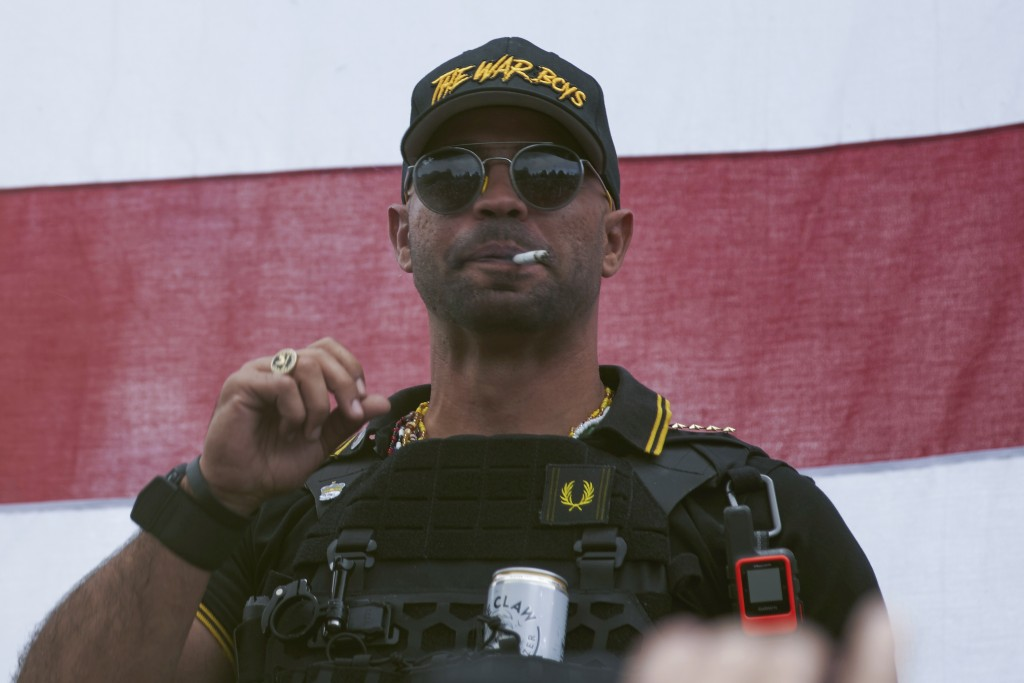 """FILE - In this Sept. 26, 2020, file photo, Proud Boys leader Henry """"Enrique"""" Tarrio wears a hat that says The War Boys during a rally in Portland, Ore..."""