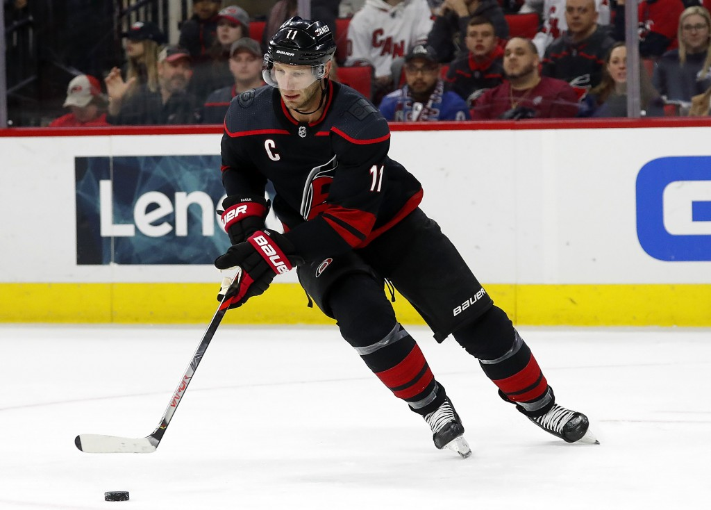 FILE - In this Feb. 28, 2020, file photo, Carolina Hurricanes' Jordan Staal (11) controls the puck against the Colorado Avalanche during the first per...