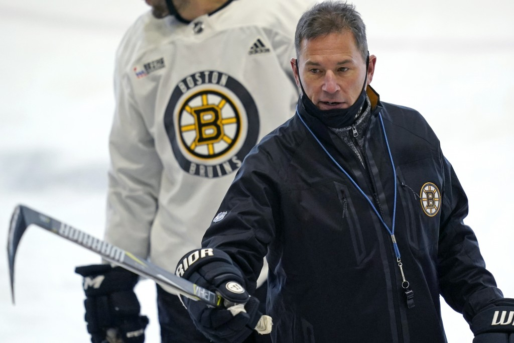 Boston Bruins head coach Bruce Cassidy instructs his players at the team's NHL hockey training camp, Monday, Jan. 4, 2021, in Boston. (AP Photo/Elise ...