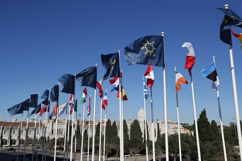 The flags of the European Union countries fly outside the Belem Cultural Center in Lisbon ahead of the meeting of the President of the European Counci...