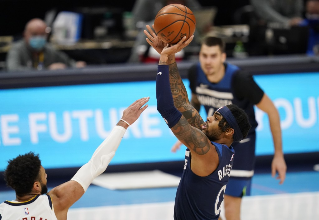 Minnesota Timberwolves guard D'Angelo Russell shoots over Denver Nuggets guard Jamal Murray during the second half of an NBA basketball game Tuesday, ...