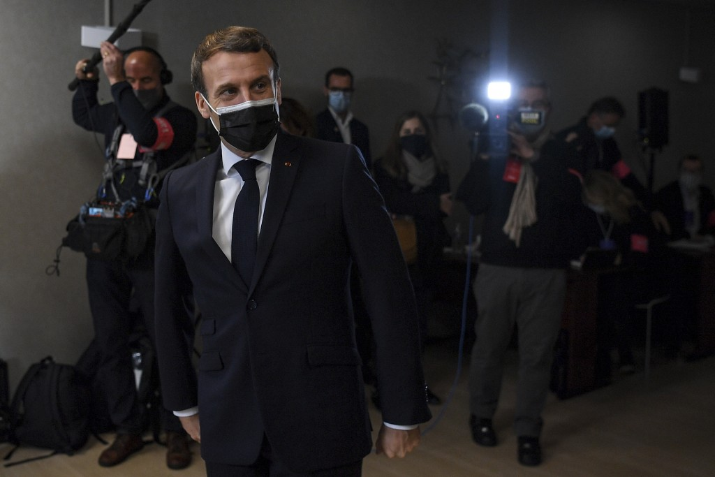 French President Emmanuel Macron, left, meets employees at the headquarters of the local CAF (French family allowance public services) in Tours, centr...