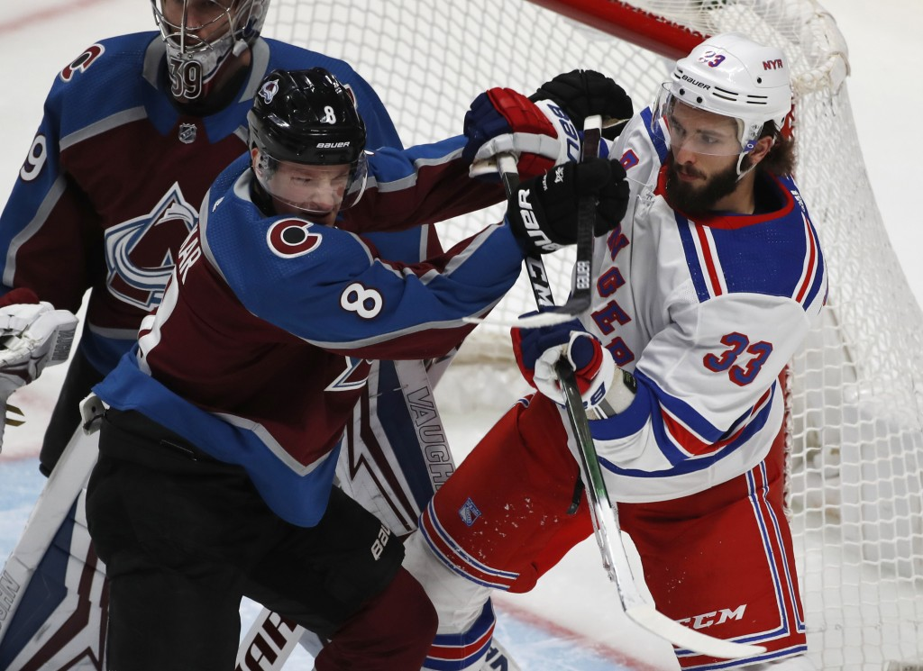 FILE - Colorado Avalanche defenseman Cale Makar (8) fights for position in front of the net with New York Rangers left wing Phillip Di Giuseppe (33) i...