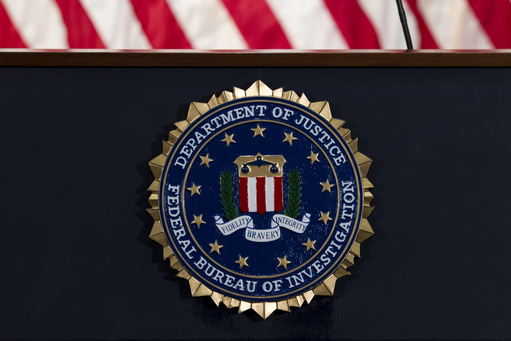 FILE - In this June 14, 2018, file photo, the FBI seal is seen before a news conference at FBI headquarters in Washington. The U.S. government on Tues...