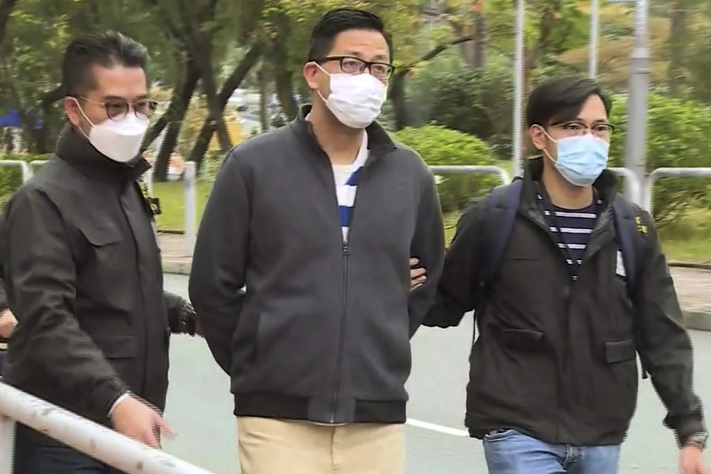 In this image taken from a video, Hong Kong's Democratic Party member and former lawmaker Lam Cheuk-ting, center, is arrested by police officers at hi...