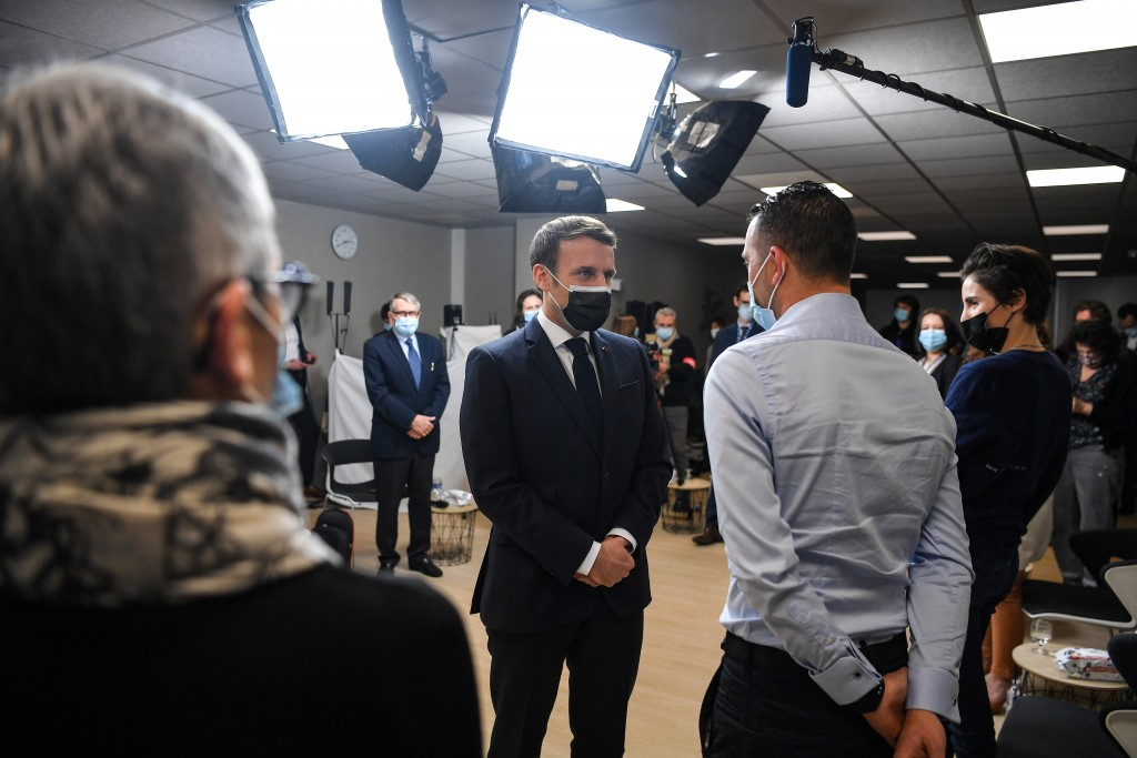 French President Emmanuel Macron, center, meets employees at the headquarters of the local CAF (French family allowance public services) in Tours, cen...