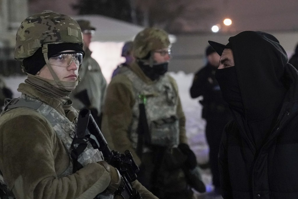 A protester confronts a National Guard member outside a museum, Tuesday, Jan. 5, 2021, in Kenosha, Wis. Earlier it was announced that no charges will ...
