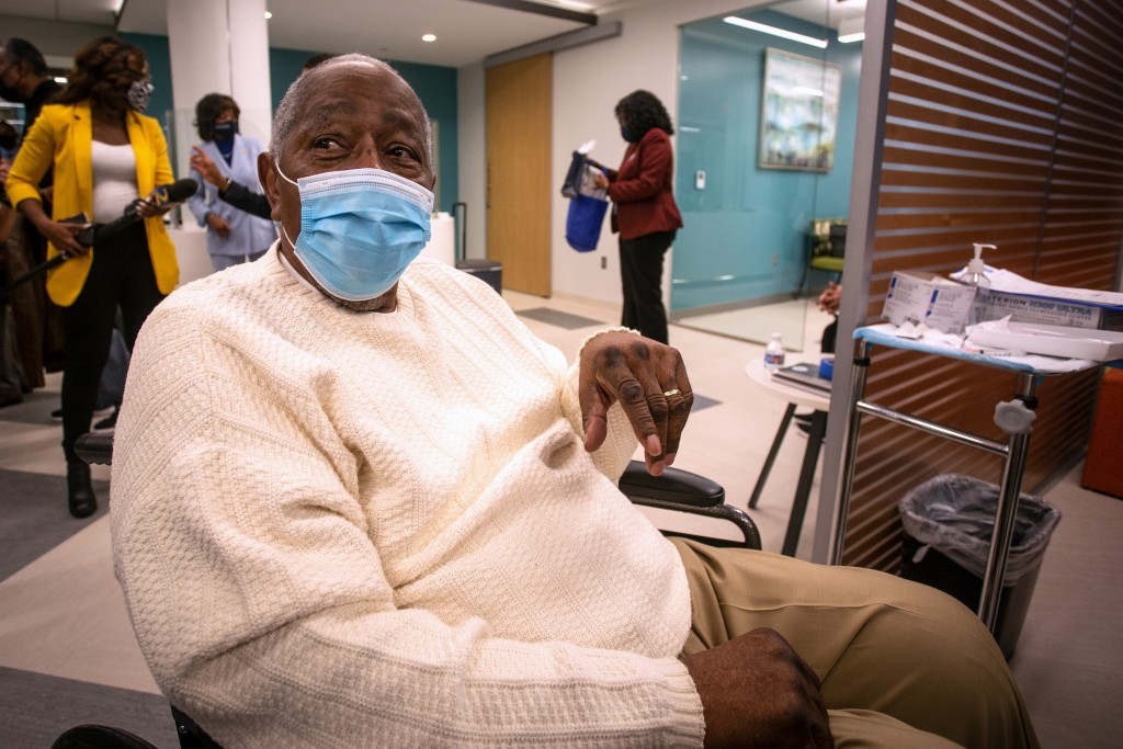 Baseball Hall of Famer Hank Aaron waits to receive his COVID-19 vaccination on Tuesday, Jan. 5, 2021, at the Morehouse School of Medicine in Atlanta. ...