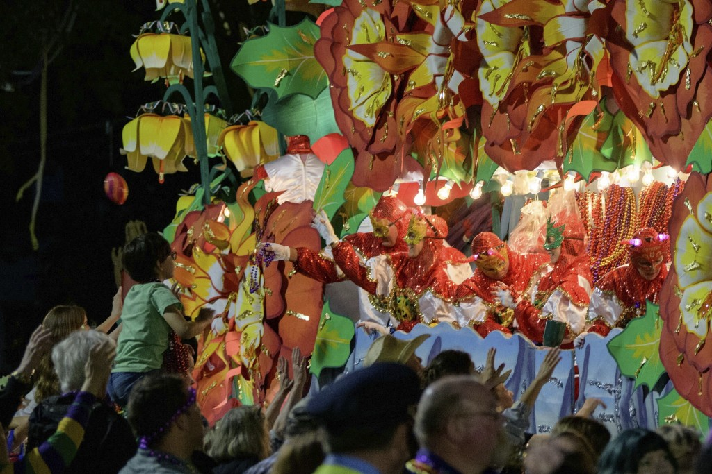 """FILE - In this Monday, Feb. 24, 2020, file photo, float riders throw beads from a float with the theme """"Beastly Kingdoms,"""" in the Krewe of Orpheus par..."""