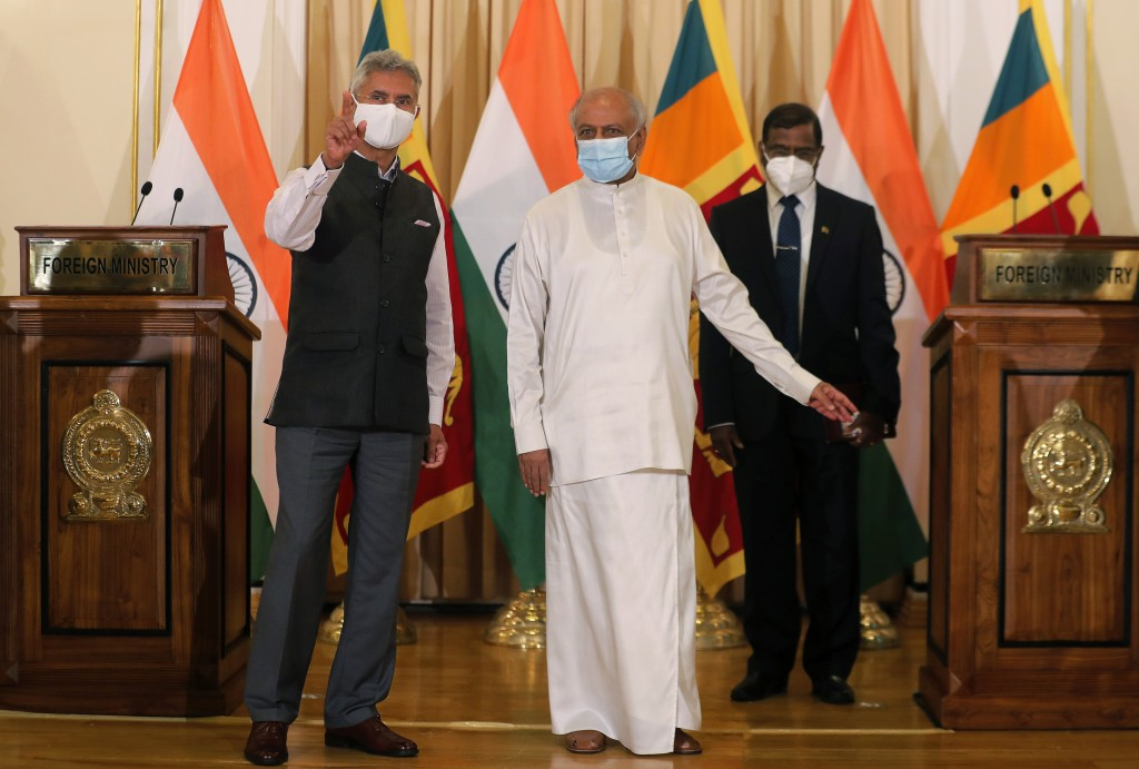Sri Lankan Foreign Minister Dinesh Gunawardena stands for a photograph with his Indian counterpart Subrahmanyam Jaishankar, left, after addressing a j...