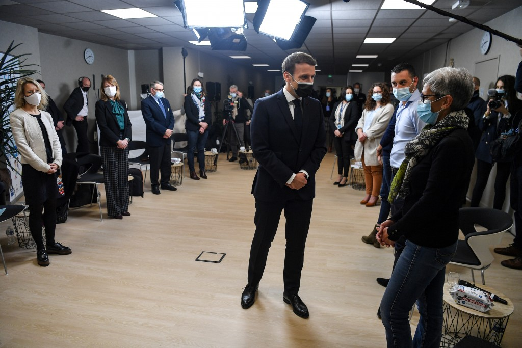 French President Emmanuel Macron meets employees at the headquarters of the local CAF (French family allowance public services) in Tours, central Fran...