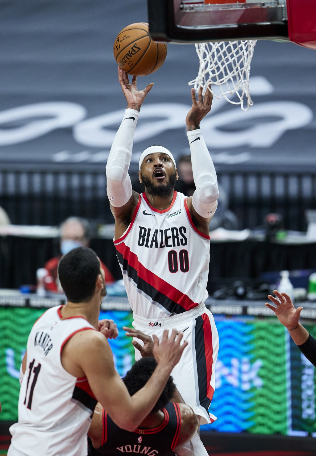 Portland Trail Blazers forward Carmelo Anthony shoots over Chicago Bulls forward Thaddeus Young during the first half of an NBA basketball game in Por...