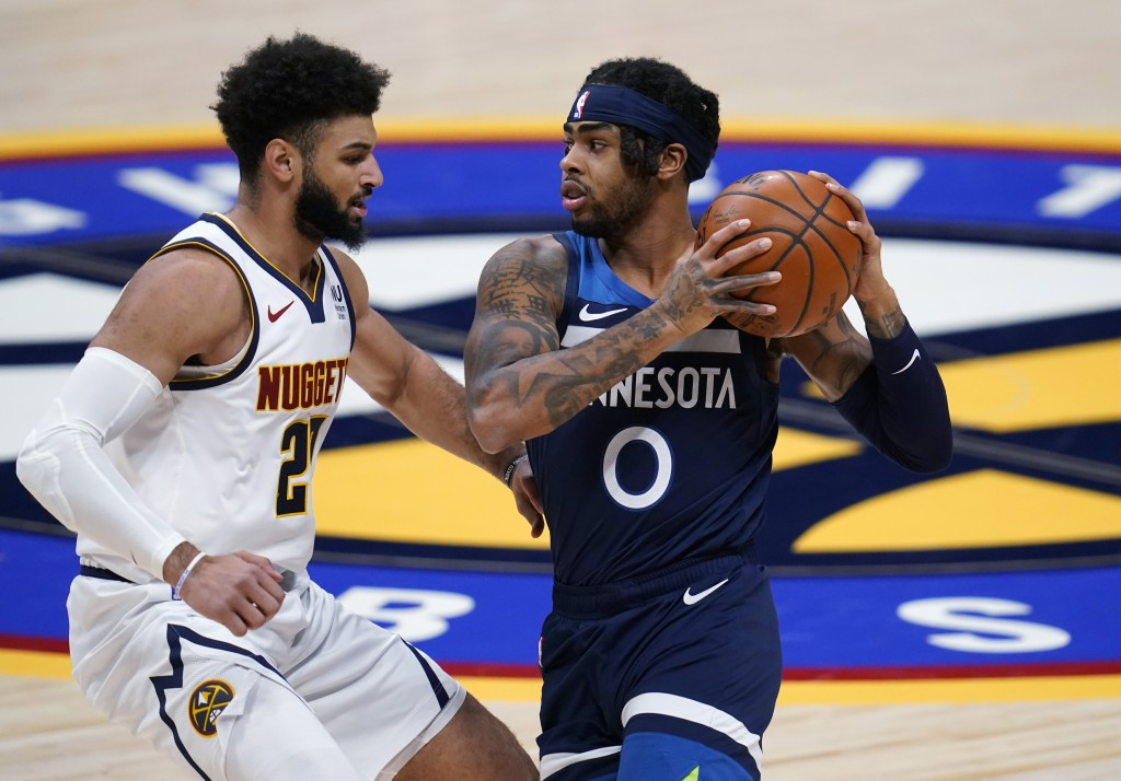 Minnesota Timberwolves guard D'Angelo Russell, right, is defended by Denver Nuggets guard Jamal Murray during the second half of an NBA basketball gam...