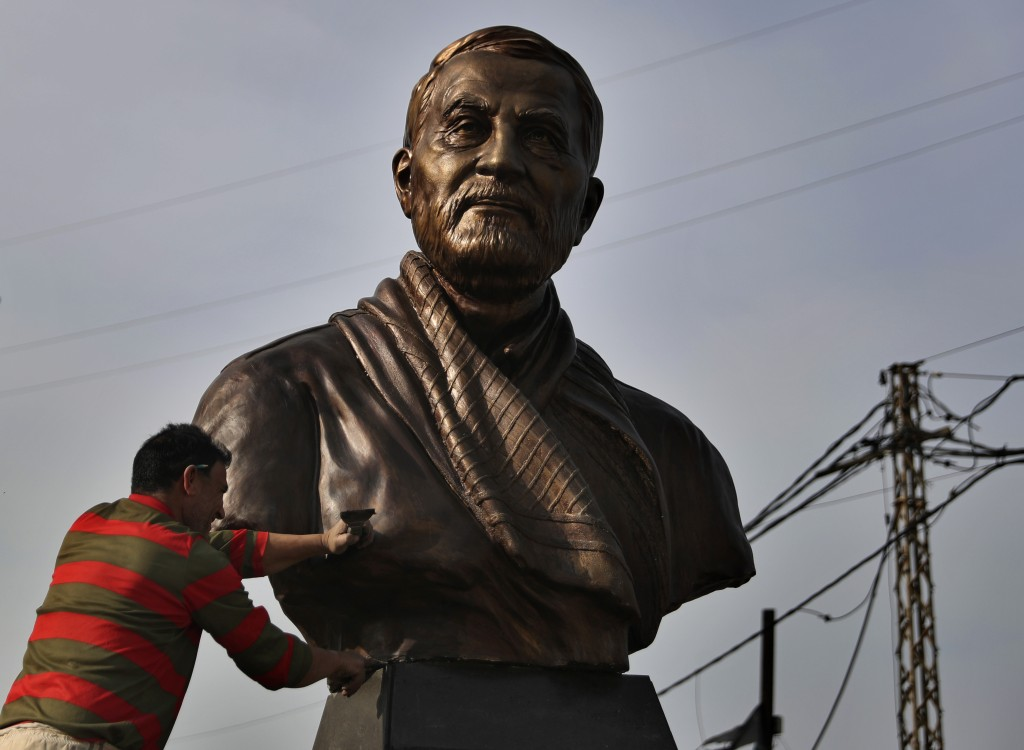 A worker cleans a statue of Iranian General Qassem Soleimani, installed to commemorate the anniversary of  his killing, in a U.S. drone strike in Bagh...