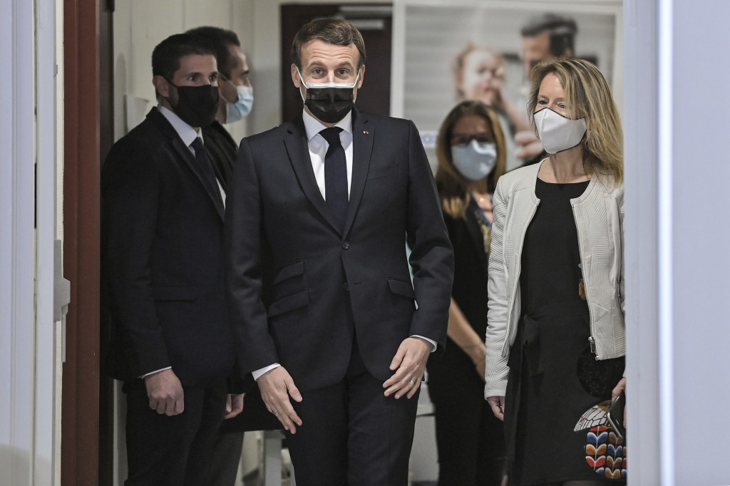French President Emmanuel Macron, center, arrives for a meeting during a visit at the headquarters of the local CAF (French family allowance public se...