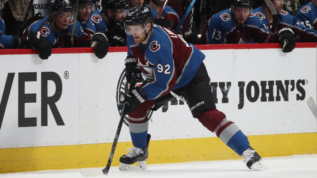 FILE - Colorado Avalanche left wing Gabriel Landeskog moves the puck down the ice in the second period of an NHL hockey game against the Bufalo Sabres...