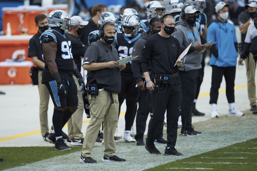 FILE - Carolina Panthers head coach Matt Rhule, left, and offensive coordinator Joe Brady watch from the sideline during an NFL football game against ...