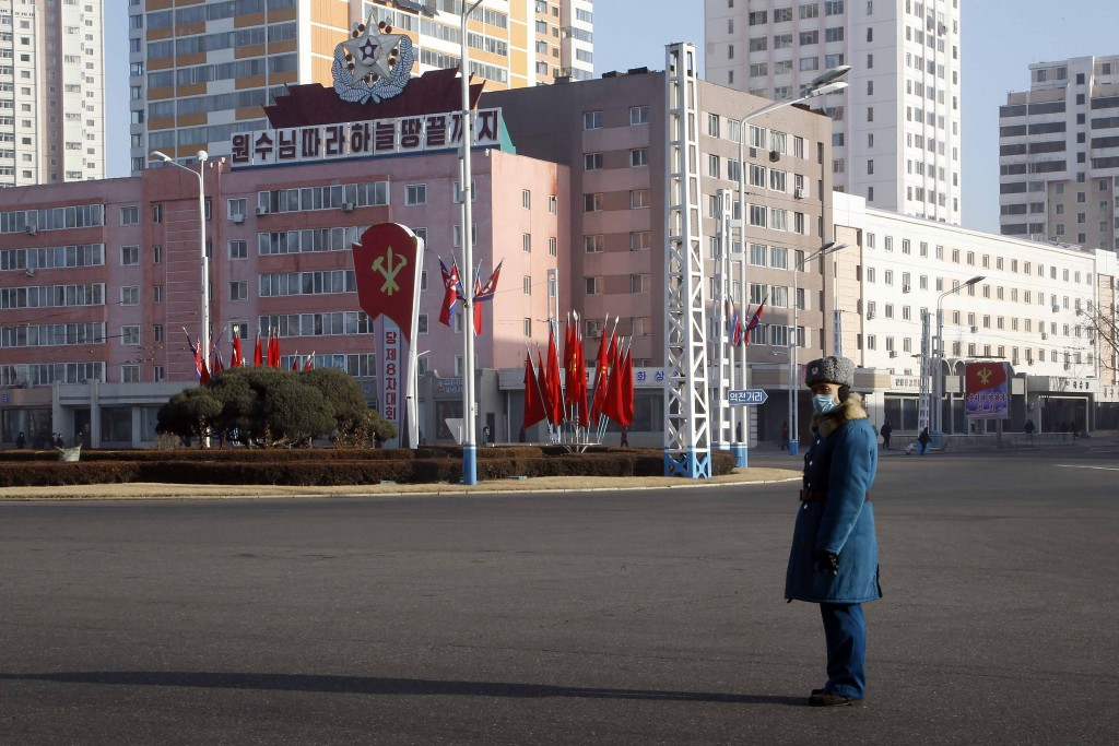 A traffic officer stand in attention along a main street of the Central District in Pyongyang, North Korea, on Wednesday, Jan. 6, 2021. The Workers' P...