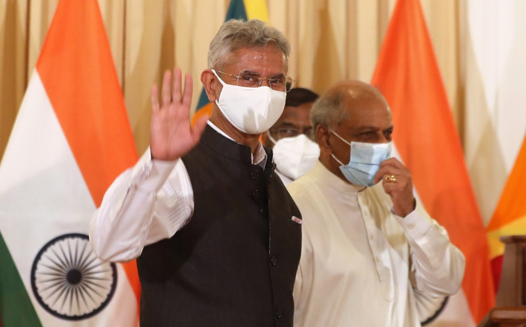 Indian Foreign Minister Subrahmanyam Jaishankar waves to the media as he leaves with his Sri Lankan counterpart Dinesh Gunawardena after addressing a ...