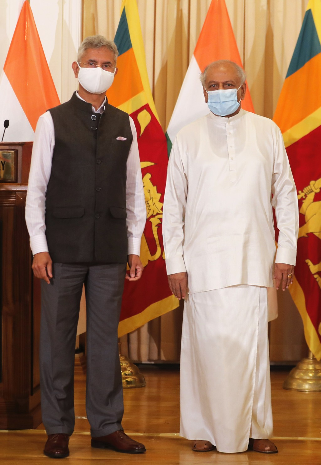 Sri Lankan Foreign Minister Dinesh Gunawardena, right, stands for a photograph with his Indian counterpart Subrahmanyam Jaishankar after addressing a ...
