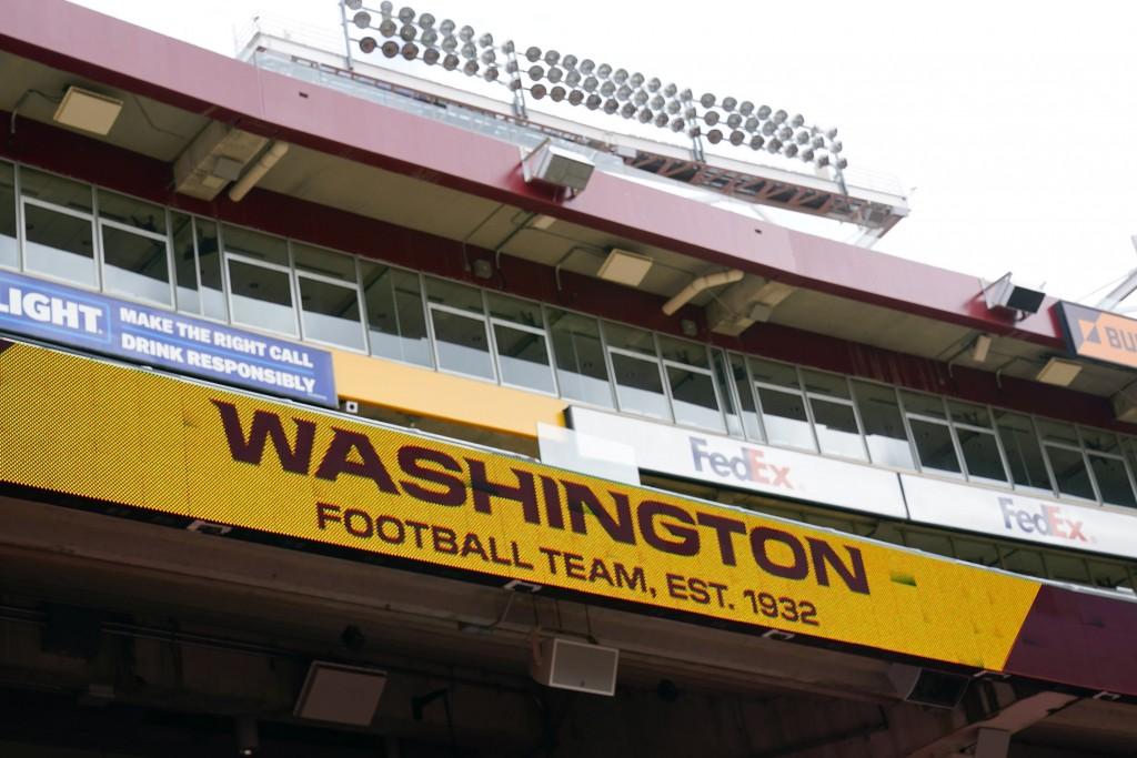 Fedex Field scoreboard displays the Washington Football Team name during warmups before the start of a NFL football game between Washington Football T...