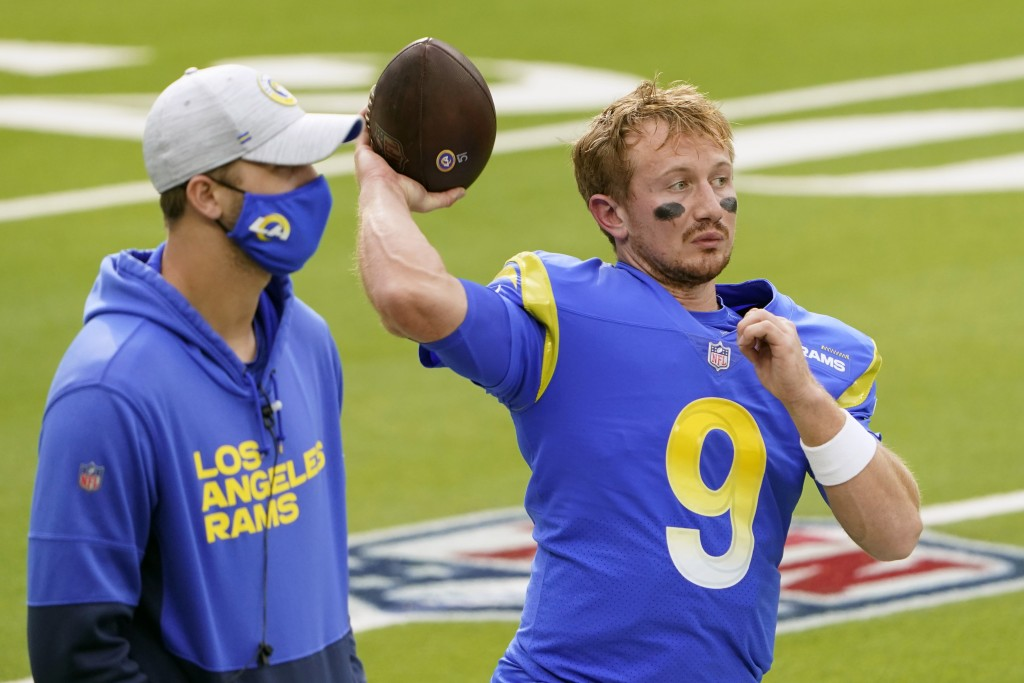Injured Los Angeles Rams quarterback Jared Goff, left, stands next to quarterback John Wolford (9) before an NFL football game against the Arizona Car...