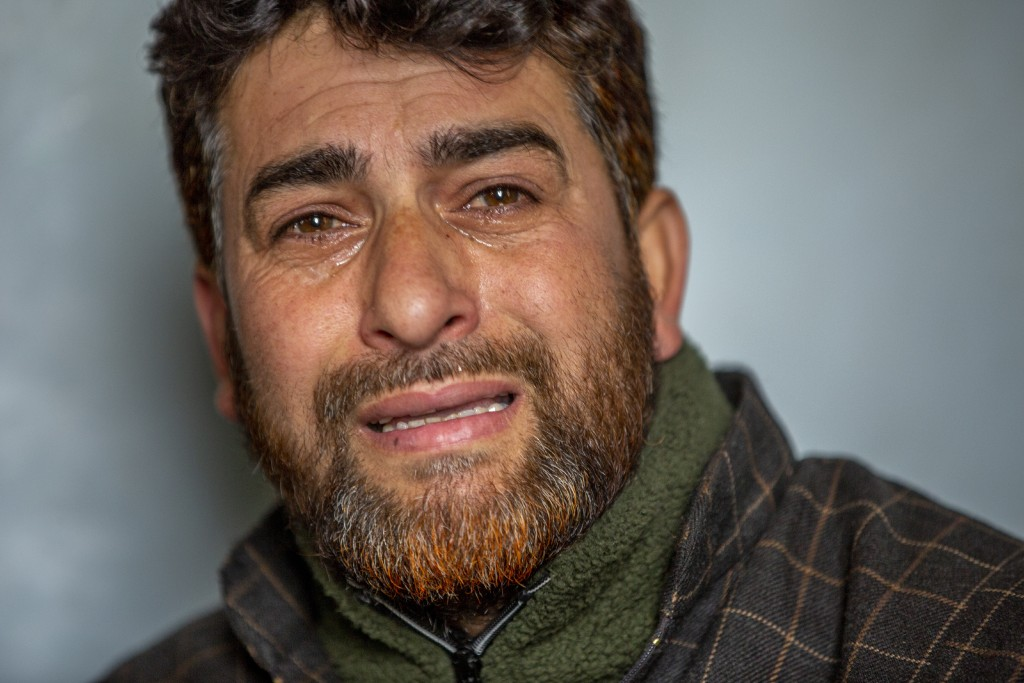 Mushtaq Ahmad Wani, father of 16-year-old Athar Mushtaq, breaks down while talking to Associated Press in Bellow, south of Srinagar, Indian controlled...