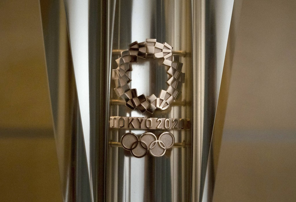 An Olympic torch for the Tokyo 2020 Olympics is on display in Tokyo, Tuesday, March 24, 2020. Japan has announced Thursday, Jan. 7, 2021, that it is h...