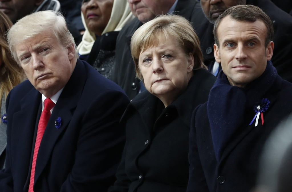 FILE - In this Nov.11, 2018 file photo, French President Emmanuel Macron, German Chancellor Angela Merkel and President Donald Trump attend a commemor...