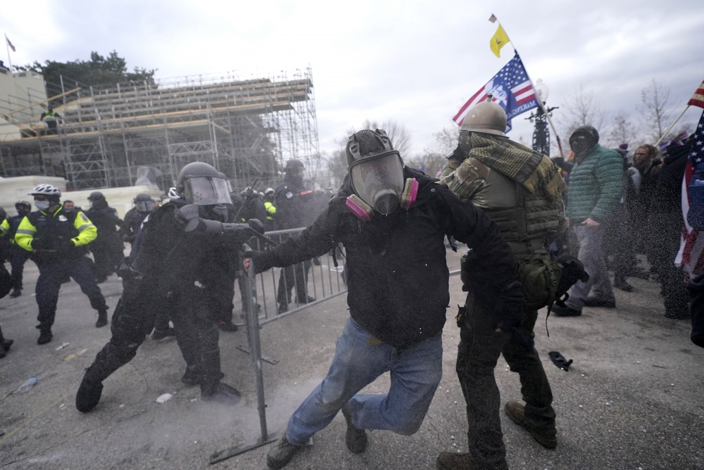 Trump supporters try to break through a police barrier, Wednesday, Jan. 6, 2021, at the Capitol in Washington. As Congress prepares to affirm Presiden...