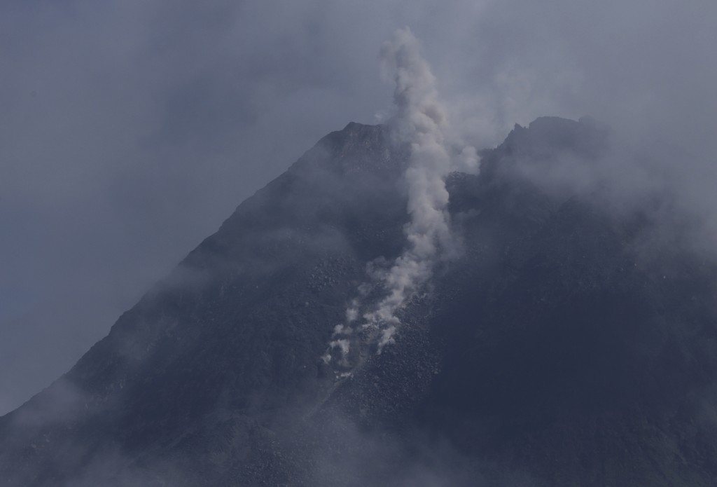 Mount Merapi spews volcanic materials from its crater as seen from Sleman, Yogyakarta, Indonesia, Thursday, Jan. 7, 2021. The 2,968-meter (9,737-foot)...