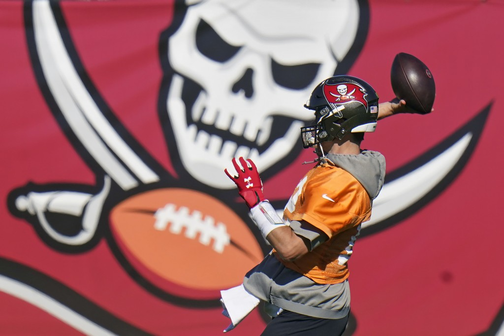 Tampa Bay Buccaneers quarterback Tom Brady (12) throws a pass during an NFL football practice Wednesday, Jan. 6, 2021, in Tampa, Fla. The Buccaneers p...