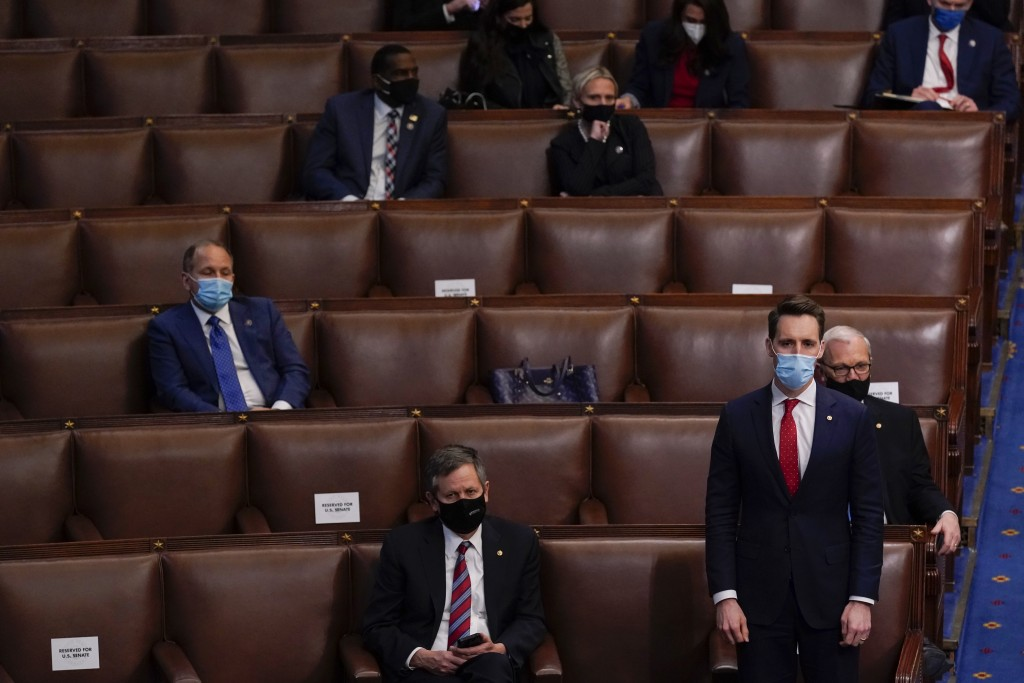 Sen. Josh Hawley, R-Mo., rises to join House Republican members to object to confirming the Electoral College votes from Pennsylvania during a joint s...