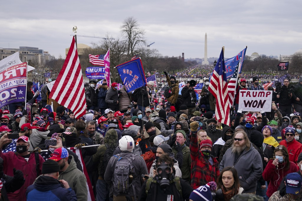 Trump supporters gather outside the Capitol, Wednesday, Jan. 6, 2021, in Washington. As Congress prepares to affirm President-elect Joe Biden's victor...