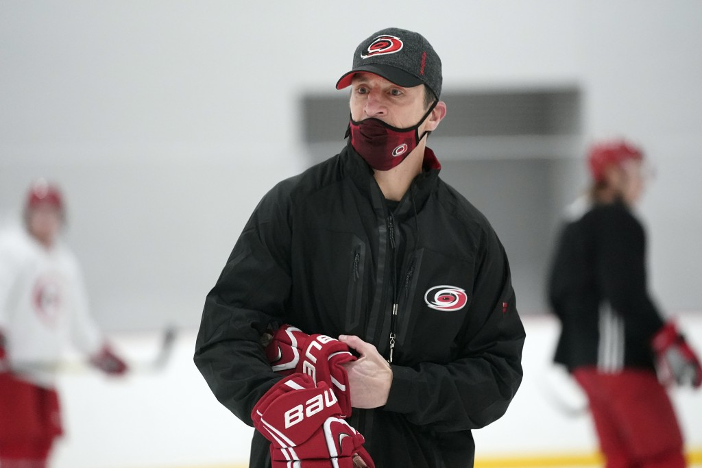 Carolina Hurricanes coach Rod Brind'Amour conducts drills during NHL hockey training camp in Morrisville, N.C., Wednesday, Jan. 6, 2021. (AP Photo/Ger...