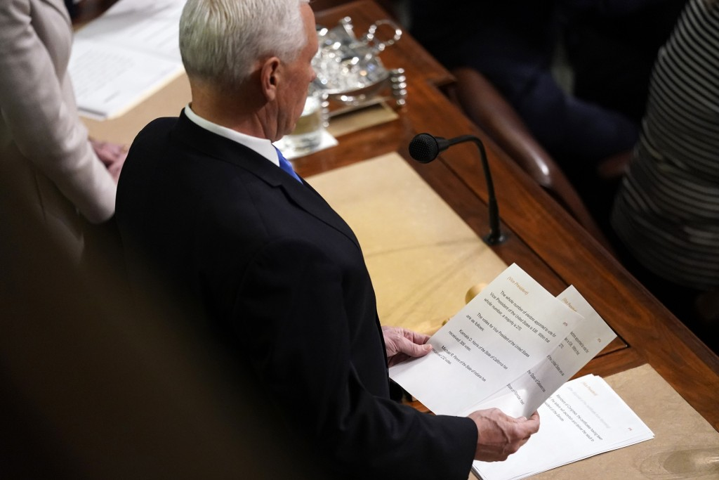 Vice President Mike Pence announces the election of President and Vice President as he officiates a joint session of the House and Senate to confirm E...