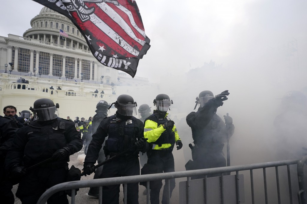 Police hold off Trump supporters who tried to break through a police barrier, Wednesday, Jan. 6, 2021, at the Capitol in Washington. As Congress prepa...